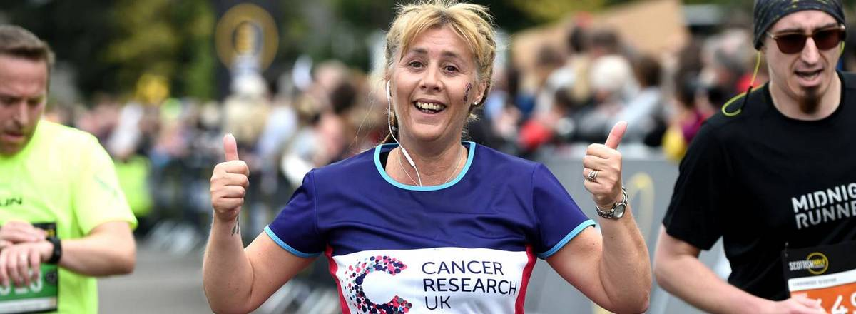 Runner in cancer research shirt