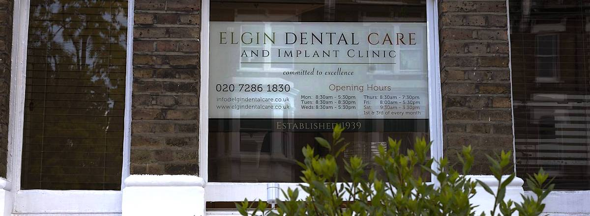 Window sign for Elgin Dental Care and implant clinic