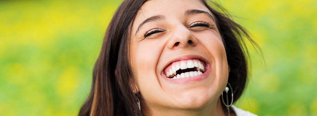 Young woman with fine white smile